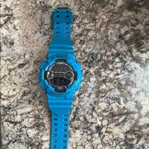 G shock bright blue watch
